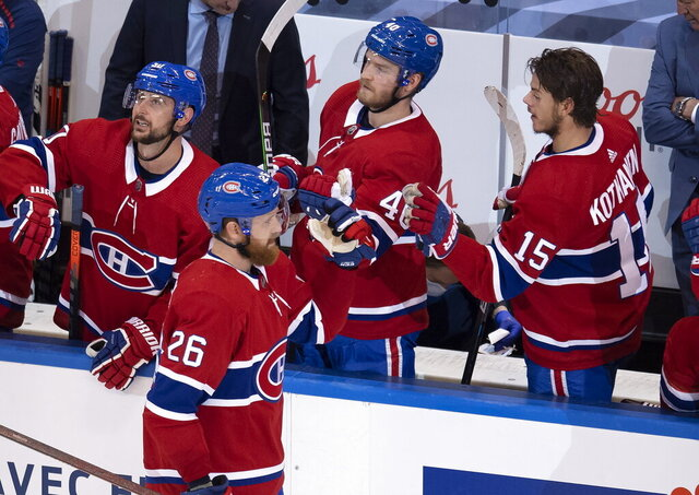 Montreal Canadiens defenseman Jeff Petry (26) is congratulated by teammates Tomas Tatar (90), Joel Armia (40) and Jesperi Kotkaniemi (15) after scoring against the Pittsburgh Penguins during the third period of an NHL hockey playoff game  Wednesday, Aug. 5, 2020 in Toronto. (Frank Gunn/The Canadian Press via AP)