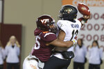 Virginia Tech defensive lineman TyJuan Garbutt (45) knocks the ball loose as Wake Forest quarterback Jamie Newman (12) attempts a pass during the second half of an NCAA college football game in Blacksburg, Va., Saturday, Nov. 9, 2019. Virginia Tech defeated Wake Forest 36-17. (AP Photo/Steve Helber)