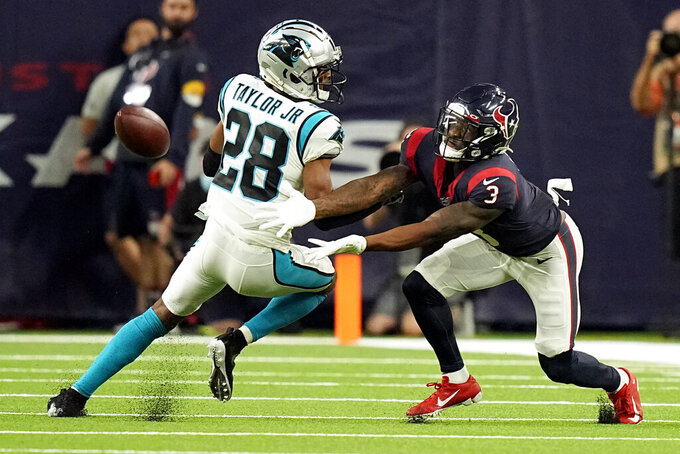 Houston Texans wide receiver Anthony Miller (3) reaches for an incomplete pass as Carolina Panthers cornerback Keith Taylor Jr. (28) defends during the second half of an NFL football game Thursday, Sept. 23, 2021, in Houston. (AP Photo/Eric Christian Smith)