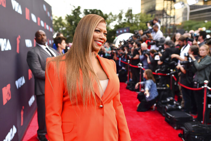 FILE - In this Monday, Aug. 26, 2019, file photo, Queen Latifah arrives at the MTV Video Music Awards at the Prudential Center in Newark, N.J. Musical artist and actress Queen Latifah is among the honorees being recognized by Harvard University this year for their contributions to black history and culture. Harvard is set to award the W.E.B. Du Bois Medal to Queen Latifah and six other recipients on Oct. 22. (Photo by Charles Sykes/Invision/AP, File)