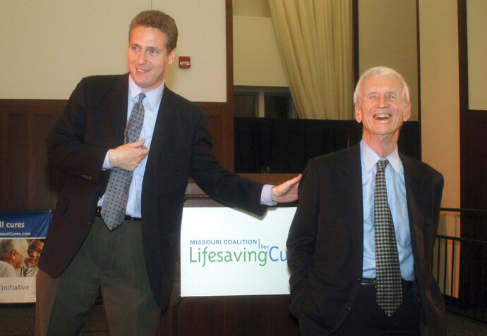 FILE - In this Nov. 8, 2006 file photo, Donn Rubin, chairman of Missouri Coalition for Lifesaving Cures, left, thanks Chancellor Emeritus William Danforth after learning Missouri voters narrowly approved a proposed state constitutional amendment to protect embryonic stem cell research early at Washington University in St. Louis, Mo.  Washington University in St. Louis confirmed that Danforth died Wednesday, Sept. 16, 2020 at his home in Ladue, Mo., He was 94. (AP Photo/Kelley McCall File)