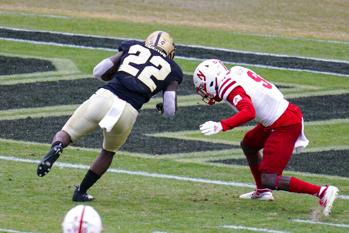 Purdue running back King Doerue (22) goes over Nebraska safety Marquel Dismuke (9) for a touchdown during the second quarter of an NCAA college football game in West Lafayette, Ind., Saturday, Dec. 5, 2020. (AP Photo/Michael Conroy)