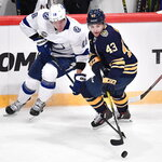 Tampa Bay Lightning's Ondrej Palat, left, and Buffalo Sabres' Conor Sheary (43) battle for the puck during an NHL hockey game in Globen Arena, Stockholm Sweden. Friday. Nov. 8, 2019. (Anders Wiklund/TT via AP)
