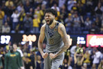 West Virginia guard Jermaine Haley (10) celebrates after a score against Baylor during the second half of an NCAA college basketball game Saturday, March 7, 2020, in Morgantown, W.Va. (AP Photo/Kathleen Batten)
