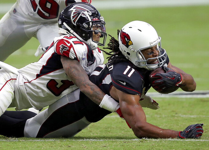 "FILE - In this Oct. 13, 2019, file photo, Arizona Cardinals wide receiver Larry Fitzgerald (11) is hit by Atlanta Falcons free safety Ricardo Allen (37) during the second half of an NFL football game in Glendale, Ariz. Armed with knowledge, Allen has taken on a leading roll with the Falcons' new ""Rise Up & Vote"" campaign, which was launched Thursday, Aug. 6, 2020, on the 55th anniversary of Lyndon Johnson signing the Voting Rights Act into law. (AP Photo/Ross D. Franklin, File)"