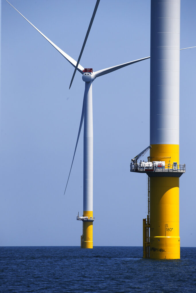 Two of the offshore wind turbines have been constructed off the coast of Virginia Beach, Va., Monday June 29, 2020. Two wind turbines are part of an offshore wind turbine project. The turbines will begin operation in August. (AP Photo/Steve Helber)
