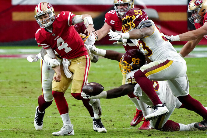 Washington Football Team defensive tackle Jonathan Allen (93) causes San Francisco 49ers quarterback Nick Mullens (4) to fumble the football during the first half of an NFL football game, Sunday, Dec. 13, 2020, in Glendale, Ariz. Washington recovered for a touchdown. (AP Photo/Rick Scuteri)