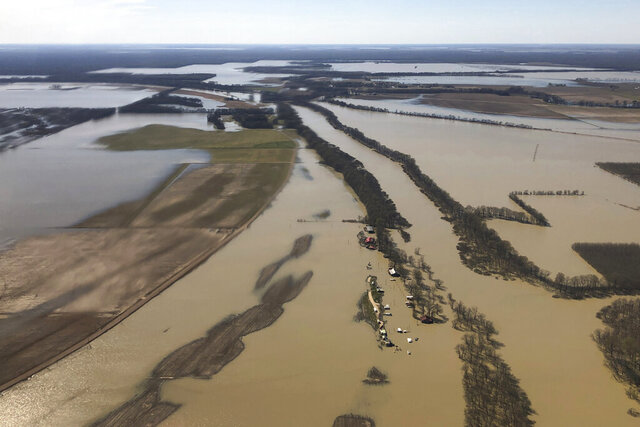 FILE - In this March 17, 2019, aerial file photo, backwater flooding covers stretches of farm land near Yazoo City, Miss. The U.S. Army Corps of Engineers issued another report Friday, Dec. 11, 2020, favoring agribusinesses over environmentalists in a decades-long battle over a massive flood control project in the south Mississippi Delta. Federally funded flood control for the Yazoo Backwater Area has been debated for decades. (AP Photo/Holbrook Mohr, File)