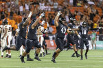 Hawaii defensive lineman Mason Vega (43) along with his teammates celebrate after Oregon State place kicker Jordan Choukair misses a game tying field goal late in the second half of an NCAA college football game, Saturday, Sept. 7, 2019, in Honolulu. Hawaii beat Oregon State 31-28. (AP Photo/Eugene Tanner)
