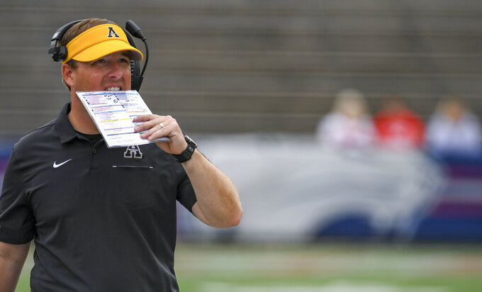 Appalachian State head coach Eliah Drinkwitz paces the sidelines during the second half of an NCAA college football game against South Alabama, Saturday, Oct. 26, 2019, at Ladd-Peebles Stadium in Mobile, Ala. (AP Photo/Julie Bennett)