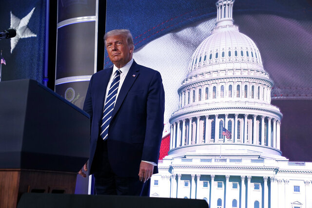 President Donald Trump stands on stage during the 2020 Council for National Policy Meeting, Friday, Aug. 21, 2020, in Arlington, Va. (AP Photo/Evan Vucci)