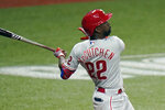 Philadelphia Phillies' Andrew McCutchen (22) follows the flight of his solo home run off Tampa Bay Rays relief pitcher Peter Fairbanks during the fifth inning of a baseball game Saturday, Sept. 26, 2020, in St. Petersburg, Fla. (AP Photo/Chris O'Meara)