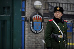 A paramilitary police officer stands guard at the gate of the Swedish Embassy in Beijing, Thursday, Feb. 14, 2019. The embassy said Thursday that Ambassador Anna Lindstedt has returned to Stockholm to be investigated by the country's foreign affairs ministry. She is not under criminal investigation. (AP Photo/Mark Schiefelbein)