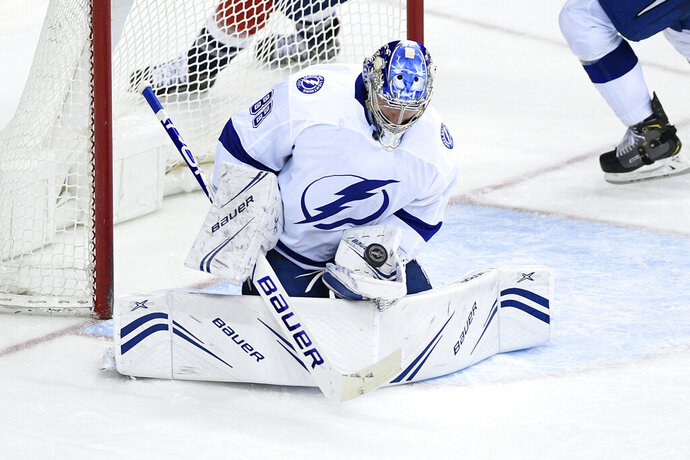 Tampa Bay Lightning goaltender Andrei Vasilevskiy, of Russia, stops the puck during the third period of the team's NHL hockey game against the Washington Capitals, Wednesday, March 20, 2019, in Washington. The Lightning won 5-4 in overtime. (AP Photo/Nick Wass)