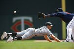 Chicago White Sox's Adam Engel, left, dives safely back to first base as Minnesota Twins first baseman Miguel Sano waits for the ball in the fourth inning of a baseball game Wednesday, Aug. 21, 2019, in Minneapolis. (AP Photo/Jim Mone)