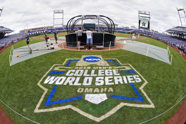 FILE - In this June 14, 2019, file photo, the College World Series logo is partially painted at TD Ameritrade Park in Omaha, Neb., as Vanderbilt players practice ahead of their College World Series game against Louisville. A group of Power Five coaches led by Michigan's Erik Bakich is proposing a later start to the college baseball season to trim expenses in the post-coronavirus era, make the game more fan friendly and reduce injury risk to players. (AP Photo/Nati Harnik, File)