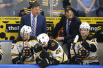 Boston Bruins head coach Bruce Cassidy, top left, watches the action during the first period of Game 6 of the NHL hockey Stanley Cup Final between the Bruins and the St. Louis Blues Sunday, June 9, 2019, in St. Louis. (AP Photo/Scott Kane)