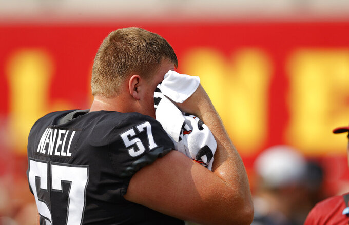 Iowa State offensive lineman Colin Newell (57) wipes the sweat from his face before an NCAA college football game against Iowa, Saturday, Sept. 11, 2021, in Ames, Iowa. (AP Photo/Matthew Putney)