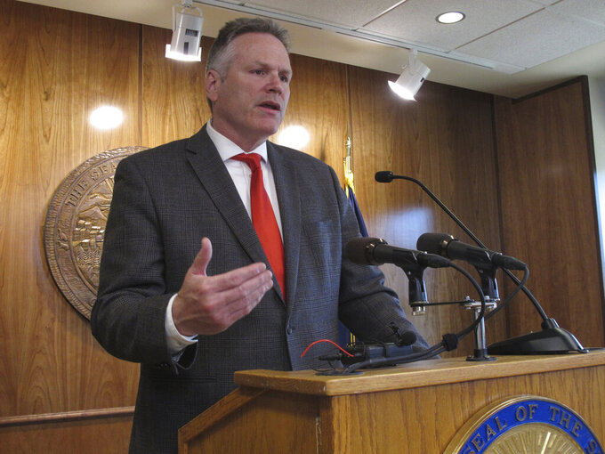 """Alaska Gov. Mike Dunleavy speaks to reporters during a news conference in Juneau, Alaska, Thursday, June 17, 2021. Dunleavy said the budget lawmakers approved this week is """"defective"""" and said he is prepared to call another special session if action is not taken before the current special session expires Friday. (AP Photo/Becky Bohrer)"""