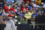 St. Louis Cardinals' Nolan Arenado hits a two-run home run during the first inning of a baseball game against the Milwaukee Brewers, Monday, Sept. 20, 2021, in Milwaukee. (AP Photo/Aaron Gash)