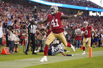 San Francisco 49ers' Jeff Wilson Jr. (41) scores against the Los Angeles Chargers during the first half of an NFL preseason football game in Santa Clara, Calif., Thursday, Aug. 29, 2019. (AP Photo/Tony Avelar)