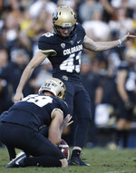 Colorado holder Alex Kinney, front, places the ball for place kicker Evan Price to kick the winning field goal as time expires in the second half of an NCAA college football game against Stanford, Saturday, Nov. 9, 2019, in Boulder, Colo. Colorado won 16-13. (AP Photo/David Zalubowski)