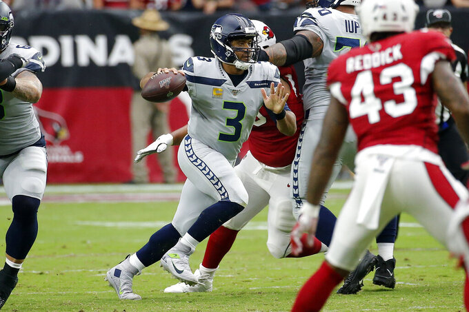 Seattle Seahawks quarterback Russell Wilson (3) scrambles against the Arizona Cardinals during the first half of an NFL football game, Sunday, Sept. 29, 2019, in Glendale, Ariz. (AP Photo/Rick Scuteri)