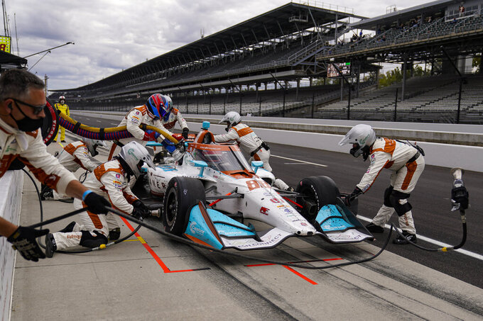 Colton Herta pits during an IndyCar auto race at Indianapolis Motor Speedway in Indianapolis, Friday, Oct. 2, 2020. (AP Photo/Michael Conroy)