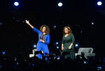 Michelle Obama, left, and Oprah Winfrey participate at