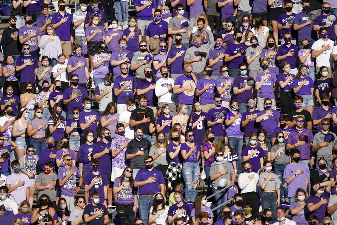 Kansas State fans and students stand for the national anthem before an NCAA college football game against Oklahoma State in Manhattan, Kan., Saturday, Nov. 7, 2020. (AP Photo/Orlin Wagner)