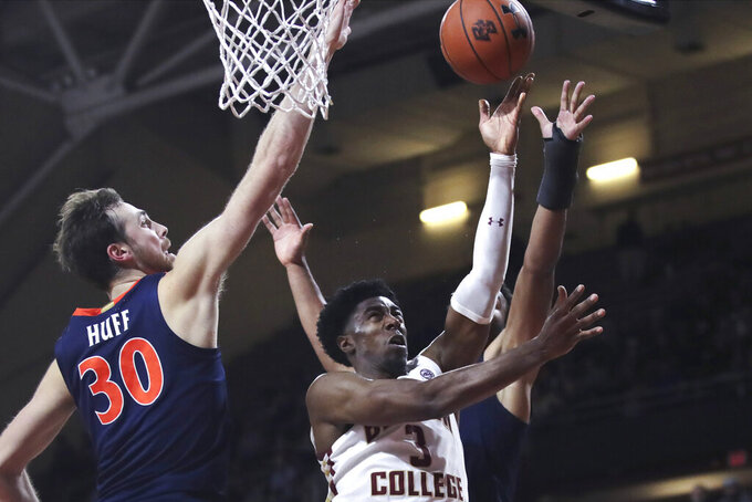 Boston College guard Jared Hamilton (3) drives to the basket past Virginia forward Jay Huff (30) during the second half of an NCAA college basketball game Tuesday, Jan. 7, 2020 in Boston. Boston College upset Virginia 60-53. (AP Photo/Charles Krupa)