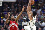 Milwaukee Bucks forward Giannis Antetokounmpo (34) shoots over Toronto Raptors forward Kawhi Leonard (2) during the second half of Game 5 of the NBA basketball playoffs Eastern Conference finals in Milwaukee on Thursday, May 23, 2019. (Frank Gunn/The Canadian Press via AP)