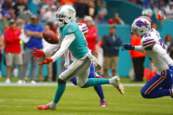 Miami Dolphins wide receiver Allen Hurns (17) fumbles a pass during the first half at an NFL football game, Sunday, Nov. 17, 2019, in Miami Gardens, Fla. (AP Photo/Wilfredo Lee)