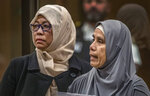 Noraini Abbas Milne, right, mother of 14-year-old mosque shooting victim, Sayyad, makes her victim impact statement during the sentencing hearing for Australian Brenton Harrison Tarrant at the Christchurch High Court after Tarrant pleaded guilty to 51 counts of murder, 40 counts of attempted murder and one count of terrorism in Christchurch, New Zealand, Tuesday, Aug. 25, 2020. More than 60 survivors and family members will confront the New Zealand mosque gunman this week when he appears in court to be sentenced for his crimes in the worst atrocity in the nation's modern history. (John Kirk-Anderson/Pool Photo via AP)