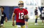 Notre Dame quarterback Tyler Buchner (12) during Notre Dame Fall Camp on Saturday, Aug. 7, 2021, at Irish Athletics Center in South Bend, Ind. (John Mersits/South Bend Tribune via AP)