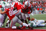 Ohio State running back TreVeyon Henderson, right, crosses the goal line for a touchdown against Oregon during the second half of an NCAA college football game Saturday, Sept. 11, 2021, in Columbus, Ohio. Oregon won 35-28. (AP Photo/Jay LaPrete)