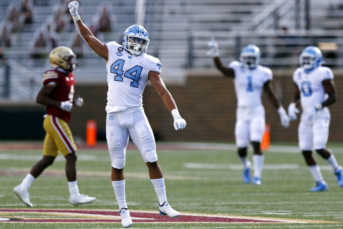 FILE - North Carolina linebacker Jeremiah Gemmel (44) celebrates after assisting in a sack of Boston College quarterback Phil Jurkovec during the first half of an NCAA college football game, in Boston, in this Saturday, Oct. 3, 2020, file photo. The Tar Heels return 18 starters from an eight-win team and are picked to win the ACC's Coastal Division. (AP Photo/Michael Dwyer, File)