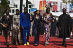 Writer director Mati Diop, fourth from left, poses with cast and crew upon arrival at the premiere of the film 'Atlantique' at the 72nd international film festival, Cannes, southern France, Thursday, May 16, 2019. (AP Photo/Petros Giannakouris)