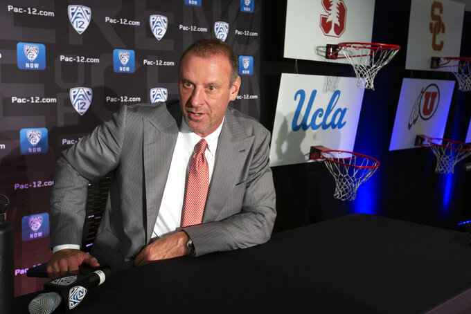 Utah head coach Larry Krystkowiak speaks during the Pac-12 NCAA college basketball media day, in San Francisco, Tuesday, Oct. 8, 2019. (AP Photo/D. Ross Cameron)
