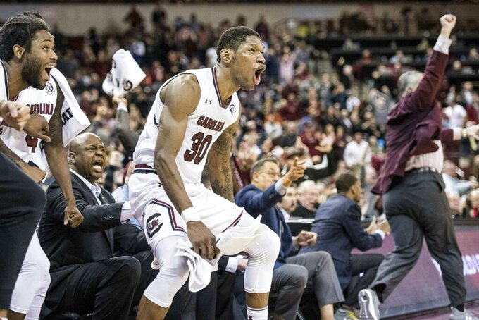 South Carolina forward Chris Silva (30) celebrates a basket during the second half of an NCAA college basketball game Tuesday, Jan. 22, 2019, in Columbia, S.C. South Carolina defeated Auburn 80-77. (AP Photo/Sean Rayford)