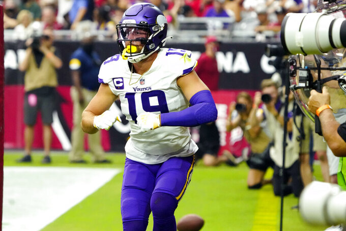Minnesota Vikings wide receiver Adam Thielen (19) celebrates his touchdown against the Arizona Cardinals during the first half of an NFL football game, Sunday, Sept. 19, 2021, in Glendale, Ariz. (AP Photo/Rick Scuteri)