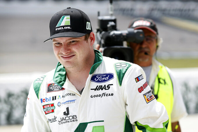 Cole Custer smiles after winning the pole position for a NASCAR Xfinity Series auto race, Sunday, June 16, 2019, at Iowa Speedway in Newton, Iowa. (AP Photo/Charlie Neibergall)