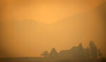 Smoke from the Cameron Peak Fire, the largest wildfire in Colorado history, fills the air in a valley near Masonville, Colo. on Saturday, Oct. 17, 2020. (Bethany Baker/Fort Collins Coloradoan via AP)