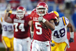 FILE - In this Nov. 24, 2006, file photo, Arkansas tailback Darren McFadden (5) runs against LSU in an NCAA college football game in Little Rock, Ark. Newly elected College Football Hall of Famers Darren McFadden, Vince Young and Lorenzo White never won the Heisman Trophy. Each was up for the award at a time when their credentials didn't quite fit the voting trends. (AP Photo/David Quinn, File)