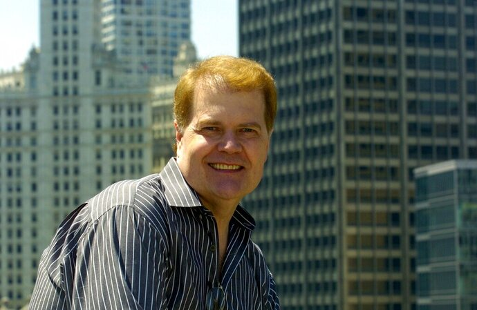File-This June 20, 2005, file photo shows Chet Coppock, a successful sports radio and TV personality in Chicago. The longtime Chicago sportscaster has died at age 70 after a car accident a week ago. His daughter, Lyndsey, says on her Facebook page her father died Wednesday, April 17, 2019. He was a passenger in an accident April 11 near Hilton Head, S.C. (David Klobucar/Chicago Tribune via AP, File)