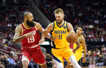 Indiana Pacers' Domantas Sabonis (11) drives toward the basket as Houston Rockets' Tyson Chandler (19) defends during the first half of an NBA basketball game Friday, Nov. 15, 2019, in Houston. (AP Photo/David J. Phillip)