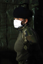 A soldier wears a face mask at the military field hospital in Mulhouse, eastern France, Wednesday, March 25, 2020. French President Emmanuel Macron launched a special military operation Wednesday to help fight the new virus in one of the world's hardest-hit countries. The new coronavirus causes mild or moderate symptoms for most people, but for some, especially older adults and people with existing health problems, it can cause more severe illness or death. (Mathieu Cugnot/Pool via AP)