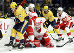 Nashville Predators center Ryan Johansen (92) and Detroit Red Wings defenseman Nick Jensen (3) compete for the puck during the second period of an NHL hockey game Tuesday, Feb. 12, 2019, in Nashville, Tenn. (AP Photo/Mark Humphrey)