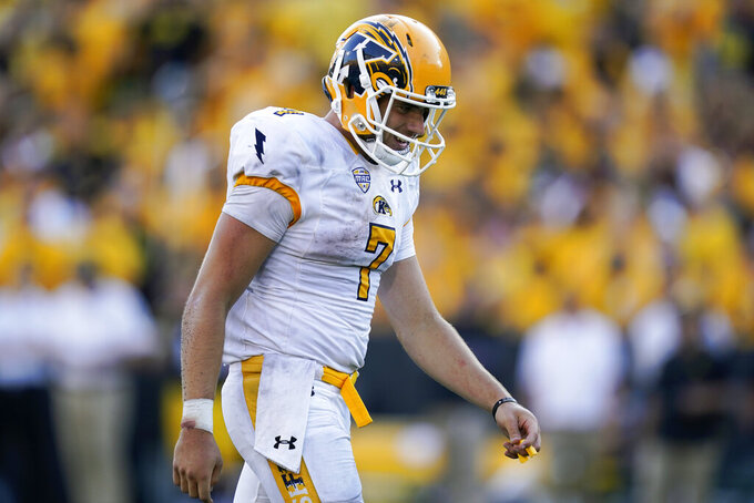 Kent State quarterback Dustin Crum (7) walks on the field after an incomplete pass during the second half of an NCAA college football game against Iowa, Saturday, Sept. 18, 2021, in Iowa City, Iowa. Iowa won 30-7. (AP Photo/Charlie Neibergall)