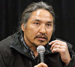 FILE - In this May 30, 2014 file photo, Chief Allan Adam of the Athabasca Chipewyan First Nation speaks during a news conference in Fort McMurray, Alberta, Canada.  Canadian Prime Minister Justin Trudeau says police dashcam video of the violent arrest of Adam is shocking and not an isolated incident. The arrest has received attention in Canada as a backlash against racism grows in the wake of the death of George Floyd, a black man who died after a white Minneapolis police officer pressed a knee to his neck.    (Jason Franson/The Canadian Press via AP)